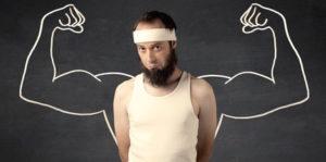 Creatin Dauereinnahme: Foto von einem jungen Mann mit Bart der Muskeln aufbauen will