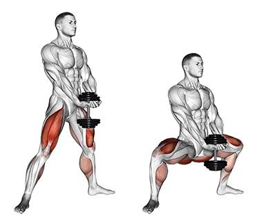 Beinmuskeln trainieren ohne Geräte: Foto von der Übung Kniebeuge breit mit 1 Kurzhantel.